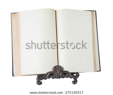 Open book with yellowed empty pages stands on a metal stand isolated on white background - stock photo