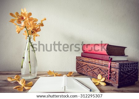 Open Books and flower, home decoration concept - stock photo