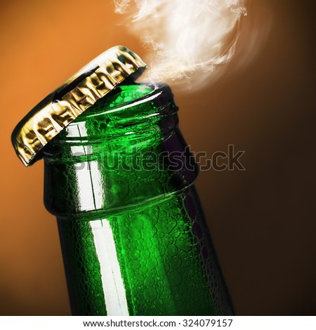 open bottle of beer on background - stock photo