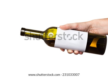 open bottle of white wine with a clear sticker in hand isolated on white background - stock photo
