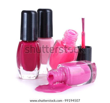 open bottles with bright nail polish isolated on white - stock photo