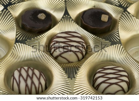 Open box of candies. Macro photo - stock photo