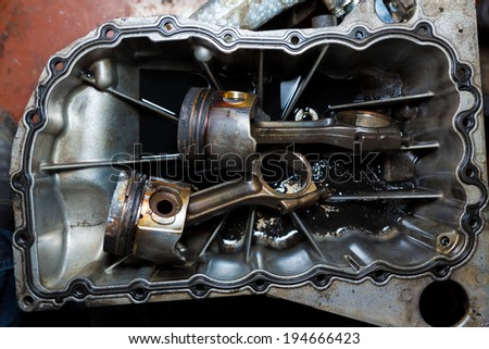 Open car engine with cylinders piston and rod of used car repair - stock photo