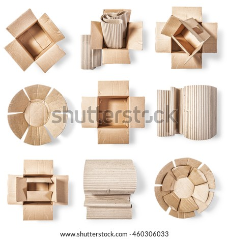 Open cardboard box, corrugated role and paper plate. Packaging material collection. Objects group  isolated on white background. Top view, flat lay - stock photo