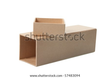 Open cardboard box laying on it's side with separate lid sitting on top, isolated over white background. - stock photo