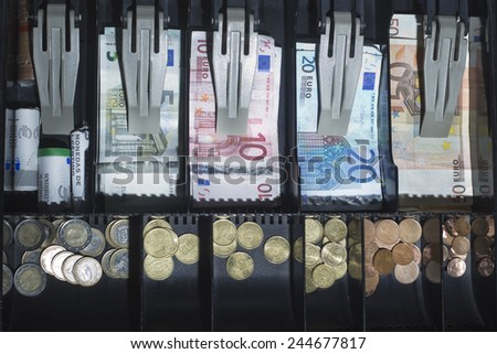 Open cash register euro - stock photo