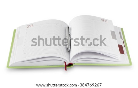 Open daily green with silver pen isolated on white background - stock photo