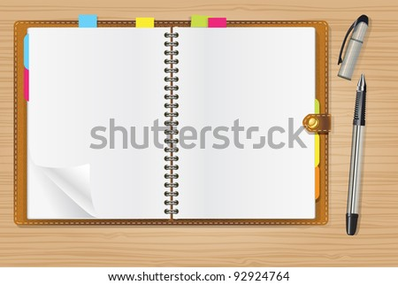 open diary and a pen on office table - stock photo