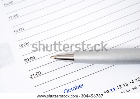 Open diary and pen for writing - stock photo