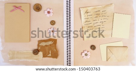 Open Diary Pages w old photo, empty tag label, paper scrap, manuscript and mail envelope scrapbooking elements - stock photo