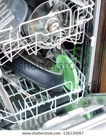 Open dishwasher after cleaning - stock photo