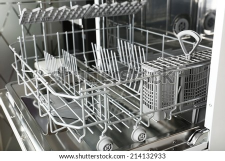 Open dishwasher without dishes in it - stock photo