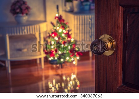 Open door and  Christmas tree in room ( Filtered image processed vintage effect. ) - stock photo