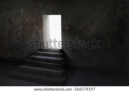 Open door and upstairs in a dark room with light outside - stock photo