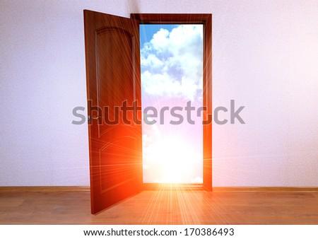 Open door to new life in room - stock photo