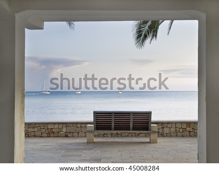 Open door to paradise. Mediterranean landscape taken from the inside of a buiding, using the frame of a door as a frame to the picture - stock photo