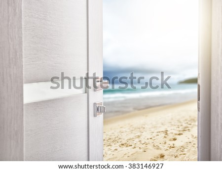 open door with access to the beach. the concept of leisure, travel and holidays - stock photo