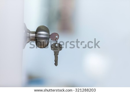 Open door with keys, key in keyhole - stock photo
