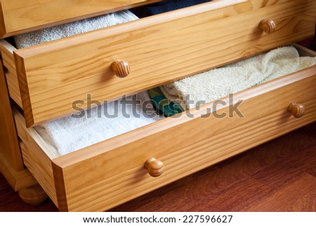 Open drawers filled with towels - stock photo