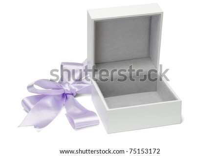 Open empty gift box and cut bow ribbon on white background - stock photo