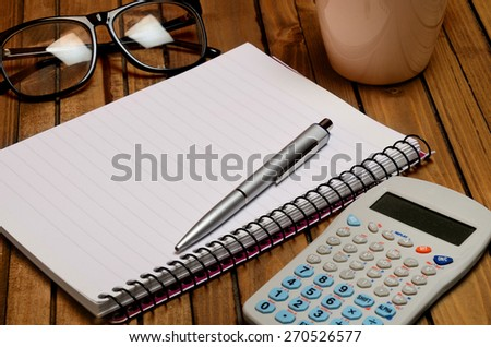 Open empty notebook with office utensil - stock photo