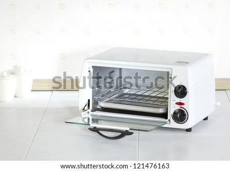Open empty roaster oven a useful home appliance in the kitchen - stock photo