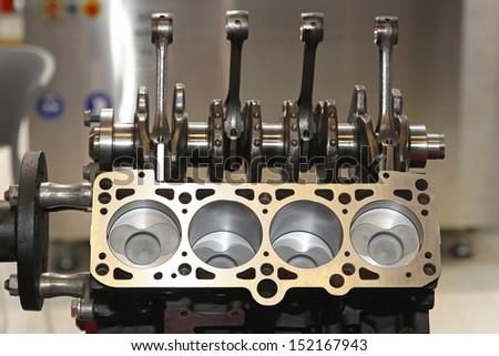 Open engine block and crankshaft in service garage - stock photo