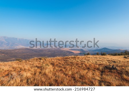 Open fields and mountain range in South Africa - stock photo
