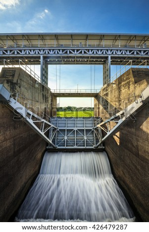 Open floodgates on a dam in a river from in thailand - stock photo