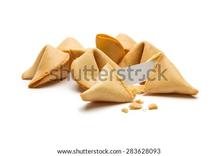 open fortune cookie with crumbs on white background - stock photo