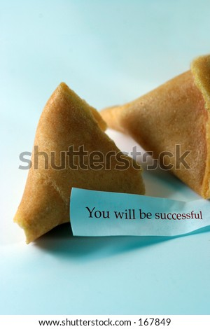 Open fortune cookie with the message you will be successful - stock photo