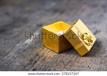 Open gift close-up on a wooden table - stock photo