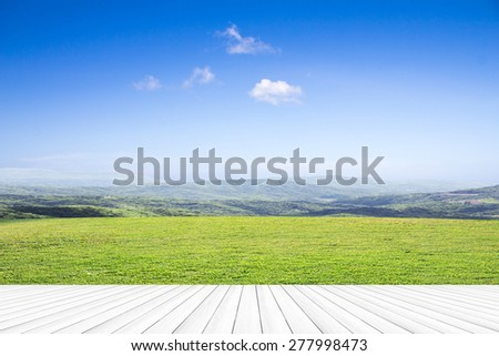 open grassland and sky.Wood floors - stock photo