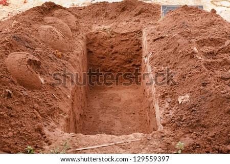 Open grave - stock photo