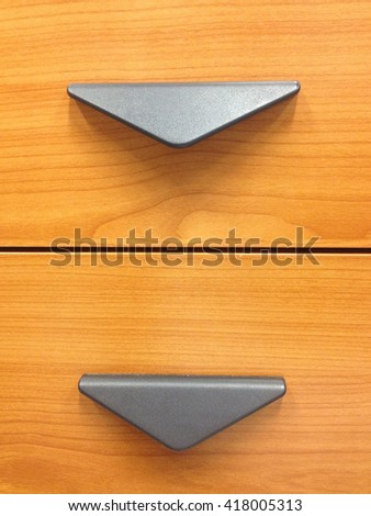 Open hand drawer black  on wooden Background. - stock photo