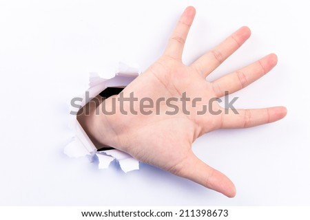 Open hand for advertise coming out from hole - stock photo