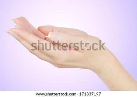 Open hand gesture on purple background - stock photo