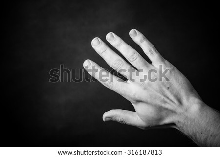 Open hand isolated black and white. - stock photo