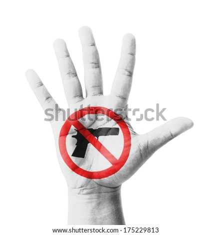 Open hand raised, No Gun sign painted, multi purpose concept - isolated on white background - stock photo