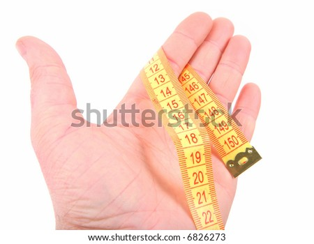 Open hand with curled yellow measuring tape on white background - stock photo