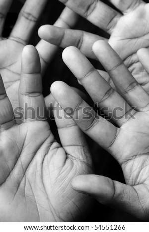 Open hands in darkness - stock photo