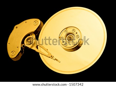 Open hard disk drive, with a golden tone - stock photo
