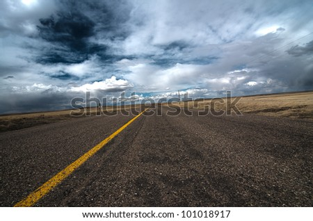 Open highway to the blue sky - stock photo