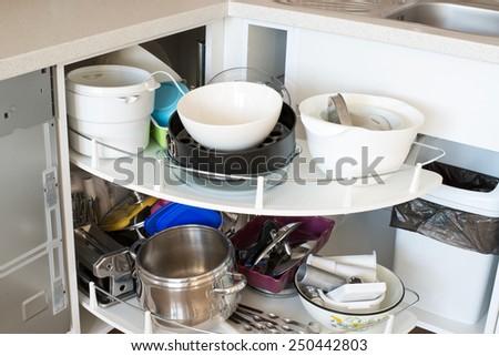 open kitchen cabinet  - stock photo