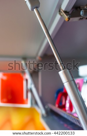 open kitchen shelf with colorful dishes, closeup - stock photo