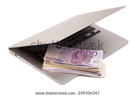 Open Laptop With Euro money isolated - stock photo