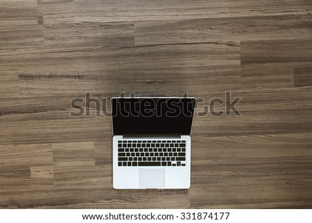 Open laptop with isolated screen on old wooden desk, View from above with copy space for design work - stock photo