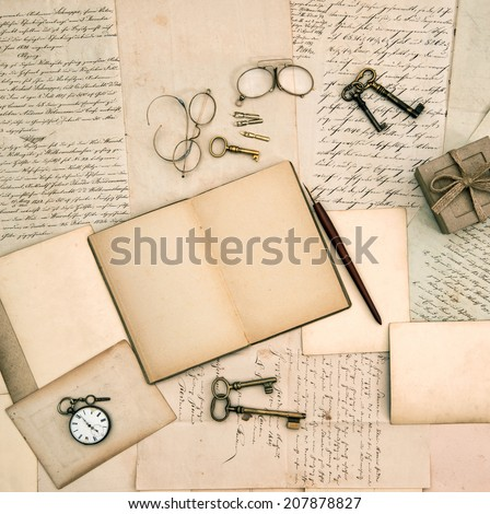 open memories book, vintage accessories, old letters and documents. nostalgic background - stock photo