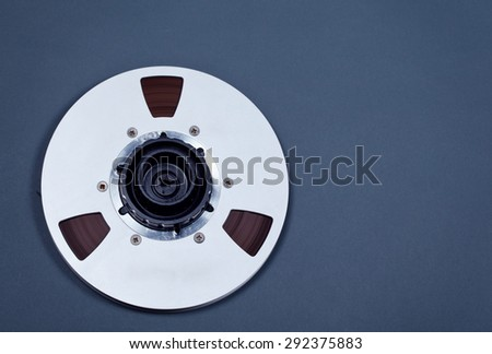 Open Metal Reel With Tape For Professional Sound Recording with NAB adapter - stock photo