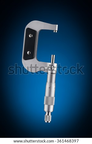 Open micrometer side view isolated on blue background - stock photo